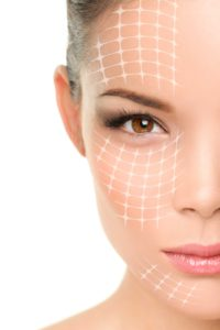Face lift anti-aging treatment - Asian woman portrait with graph
